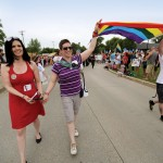 Michelle McHale (left) and her partner Karen Phillips lead thousands of revelers at Pride Steinbach on July 9, 2016. // PHOTO BY TREVOR HAGAN