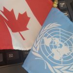 The Canadian and United Nations flags
